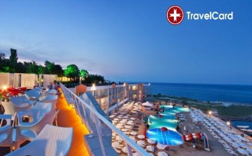 Пакет нощувки за двама възрастни плюс две деца до 12 г. на база ALL Inclusive PREMIUM на първа линия с включени безплатни чадъри и шезлонги на морския плаж в хотел Долфин Марина****  ...