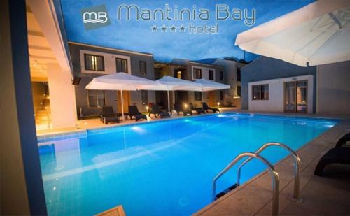 Цяло Лято на Първа Линия в Микри Мантиния, Гърция! Нощувка със Закуска + Басейн от Хотел Mantinia Bay****